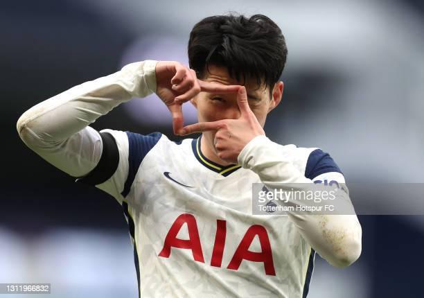 Son Heung-Min of Tottenham Hotspur celebrates after scoring their team's first goal during the Premier League match between Tottenham Hotspur and...