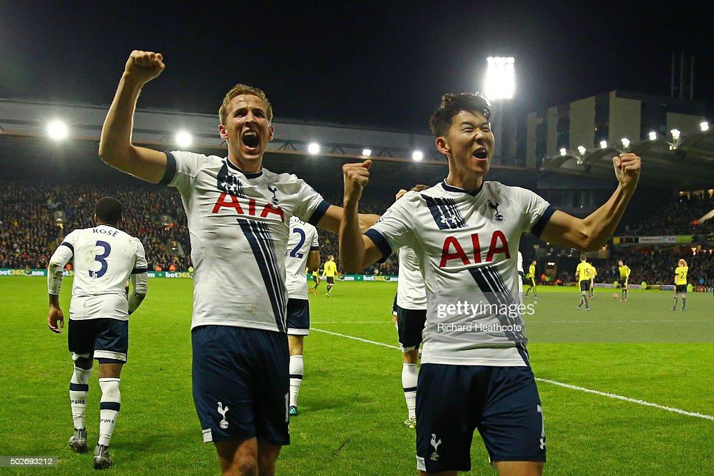 Son Heung-min (R) of Tottenham Hotspur celebrates scoring his team's second goal with his team mate Harry Kane (L) during the Barclays Premier League match between Watford and Tottenham Hotspur at Vicarage Road on December 28, 2015 in Watford, England.