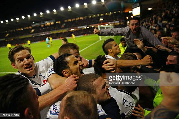 Son Heungmin of Tottenham Hotspur celebrates scoring his team's second goal with his team mates and supporters during the Barclays Premier League...