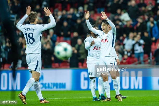 Son Heungmin of Tottenham Hotspur celebrates together with Fernando Llorente after scoring goal during the UEFA Champions League group H match...