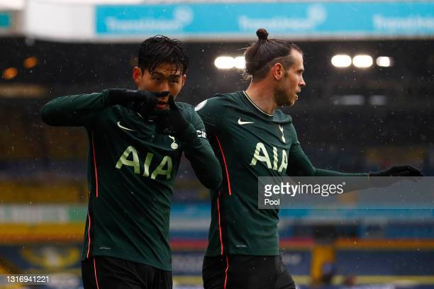Son Heung-Min of Tottenham Hotspur celebrates with Gareth Bale after scoring their side's first goal during the Premier League match between Leeds...