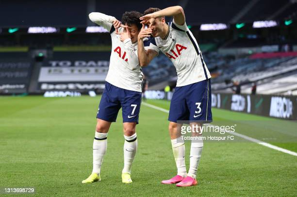 Son Heung-Min of Tottenham Hotspur celebrates with Sergio Reguilon after scoring their side's second goal during the Premier League match between...