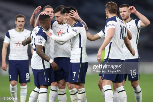 Son Heung-Min of Tottenham Hotspur celebrates with team mates after scoring their side's fourth goal during the Premier League match between...