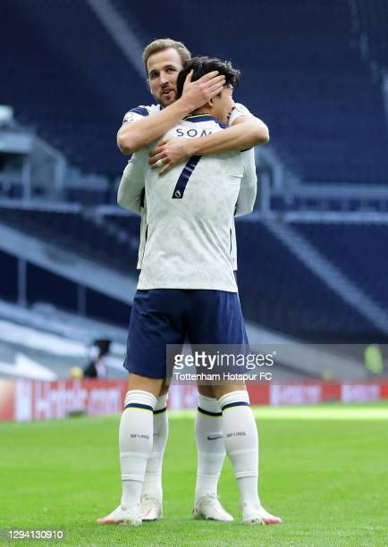 Son Heung-Min of Tottenham Hotspur celebrates with teammate Harry Kane after scoring their team's second goal during the Premier League match between...