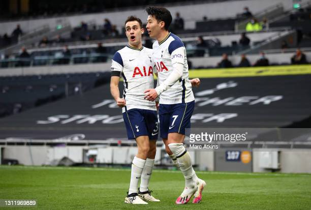 Son Heung-Min of Tottenham Hotspur celebrates with teammate Sergio Reguilon after scoring his team's first goal during the Premier League match...