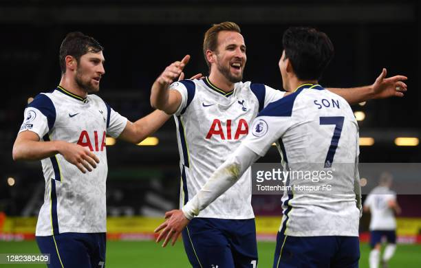Son HeungMin of Tottenham Hotspur celebrates with teammates Harry Kane and Ben Davies after scoring his team's first goal during the Premier League...