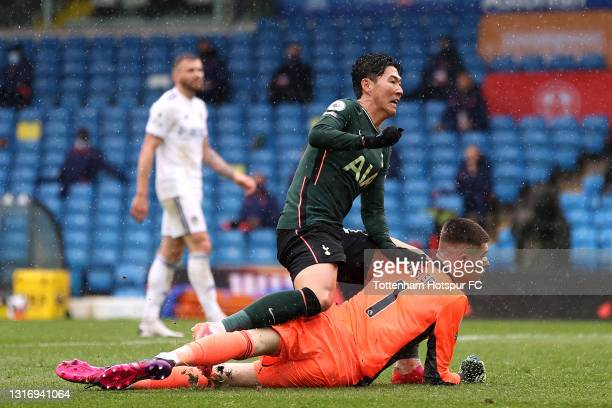Son Heung-Min of Tottenham Hotspur collides with Illan Meslier of Leeds United after scoring their side's first goal during the Premier League match...