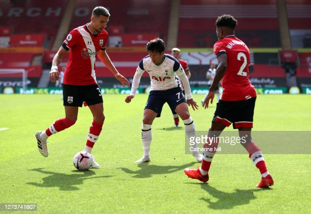 Son Heungmin of Tottenham Hotspur competes with Jan Bednarek of Southampton during the Premier League match between Southampton and Tottenham Hotspur...