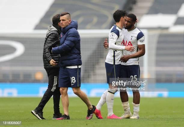 Son Heung-Min of Tottenham Hotspur embraces team mate Japhet Tanganga following victory in the Premier League match between Tottenham Hotspur and...