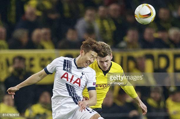 Son HeungMin of Tottenham Hotspur FC Lukasz Piszczek of Borussia Dortmund during the UEFA Europa League round of 16 match between Borussia Dortmund...