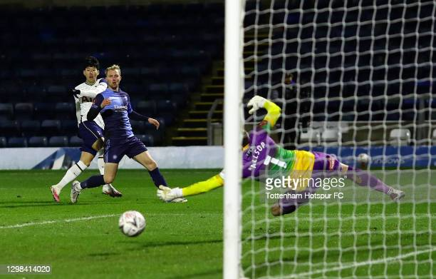 Son Heung-Min of Tottenham Hotspur has a shot on goal as Ryan Allsop of Wycombe Wanderers attempts a stage during The Emirates FA Cup Fourth Round...