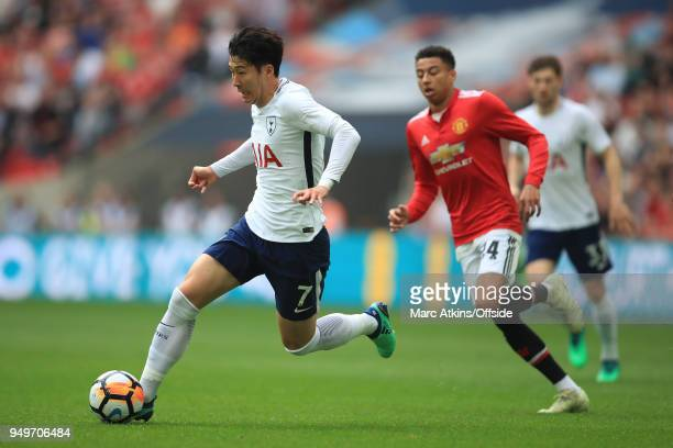 Son Heungmin of Tottenham Hotspur in action with Jesse Lingard of Manchester United during the Emirates FA Cup Semi Final at Wembley Stadium between...