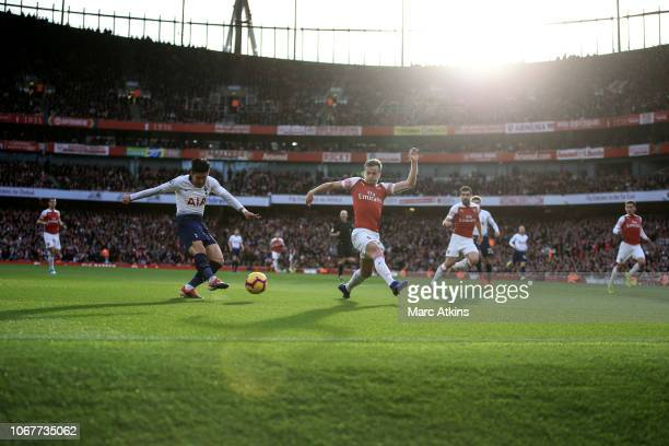 Son Heungmin of Tottenham Hotspur in action with Rob Holding of Arsenal during the Premier League match between Arsenal FC and Tottenham Hotspur at...
