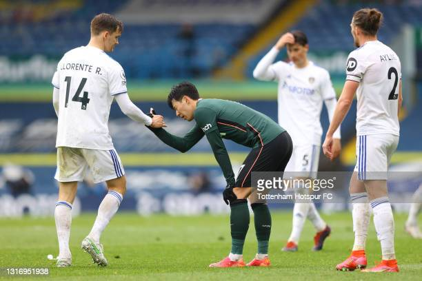 Son Heung-Min of Tottenham Hotspur interacts with Diego Llorente of Leeds United after the Premier League match between Leeds United and Tottenham...