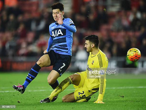 Son HeungMin of Tottenham Hotspur is challenged by goalkeeper Paulo Gazzaniga of Southampton during the Barclays Premier League match between...