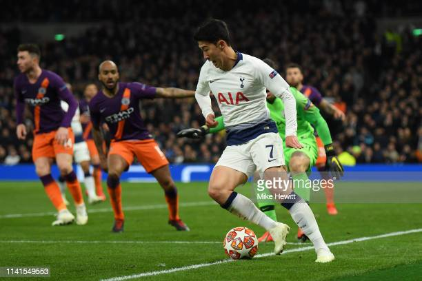 Son HeungMin of Tottenham Hotspur keeps the ball in play before going on to score the only goal during the UEFA Champions League Quarter Final first...