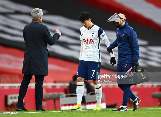 Son Heung-Min of Tottenham Hotspur leaves the pitch due to an injury during the Premier League match between Arsenal and Tottenham Hotspur at...