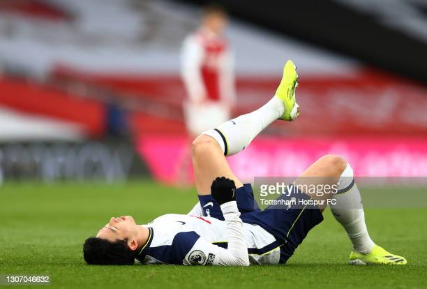 Son Heung-Min of Tottenham Hotspur lies injured during the Premier League match between Arsenal and Tottenham Hotspur at Emirates Stadium on March...