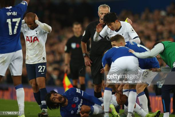 Son Heungmin of Tottenham Hotspur looks on in horror after a tackle on Andre Gomes of Everton which resulted in a red card and Gomes suffering an...
