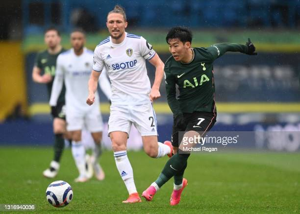 Son Heung-Min of Tottenham Hotspur makes a pass whilst under pressure from Luke Ayling of Leeds United during the Premier League match between Leeds...