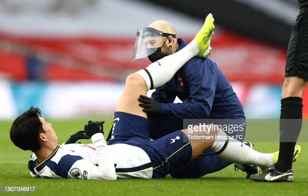 Son Heung-Min of Tottenham Hotspur receives medical treatment during the Premier League match between Arsenal and Tottenham Hotspur at Emirates...