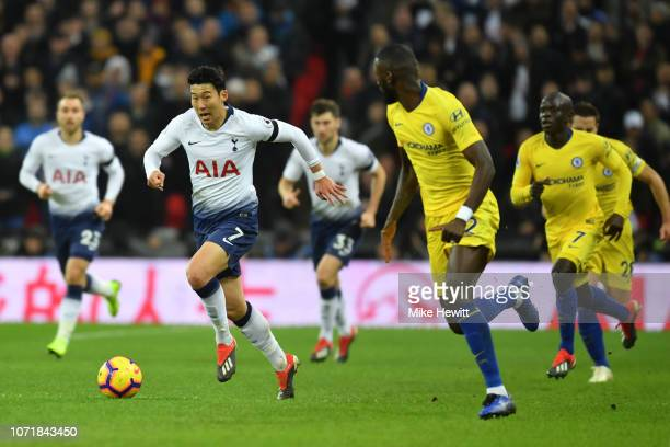 Son HeungMin of Tottenham Hotspur runs at Antonio Rudiger of Chelsea during the Premier League match between Tottenham Hotspur and Chelsea FC at...