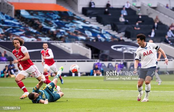 Son Heungmin of Tottenham Hotspur scores his team's first goal during the Premier League match between Tottenham Hotspur and Arsenal FC at Tottenham...