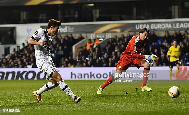 Son Heung-min of Tottenham Hotspur scores their first goal past goalkeeper Roman Weidenfeller of Borussia Dortmund during the UEFA Europa League...