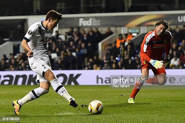 Son Heungmin of Tottenham Hotspur scores their first goal past goalkeeper Roman Weidenfeller of Borussia Dortmund during the UEFA Europa League round...