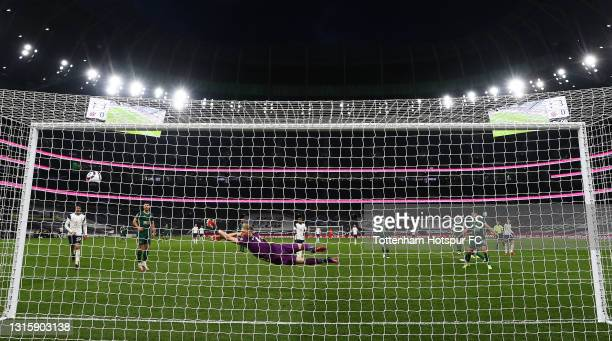 Son Heung-Min of Tottenham Hotspur scores their side's fourth goal past Aaron Ramsdale of Sheffield United during the Premier League match between...