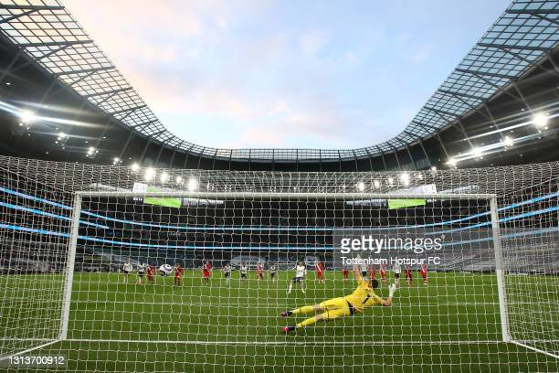 Son Heung-Min of Tottenham Hotspur scores their side's second goal past Alex McCarthy of Southampton from the penalty spot during the Premier League...
