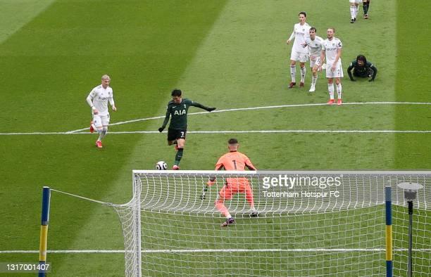 Son Heung-Min of Tottenham Hotspur scores their team's first goal past Illan Meslier of Leeds United during the Premier League match between Leeds...