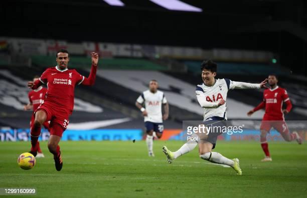 Son Heung-Min of Tottenham Hotspur shoots past Joel Matip of Liverpool during the Premier League match between Tottenham Hotspur and Liverpool at...