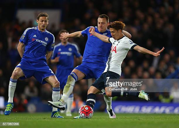 Son HeungMin of Tottenham Hotspur shoots past John Terry of Chelsea during the Barclays Premier League match between Chelsea and Tottenham Hotspur at...
