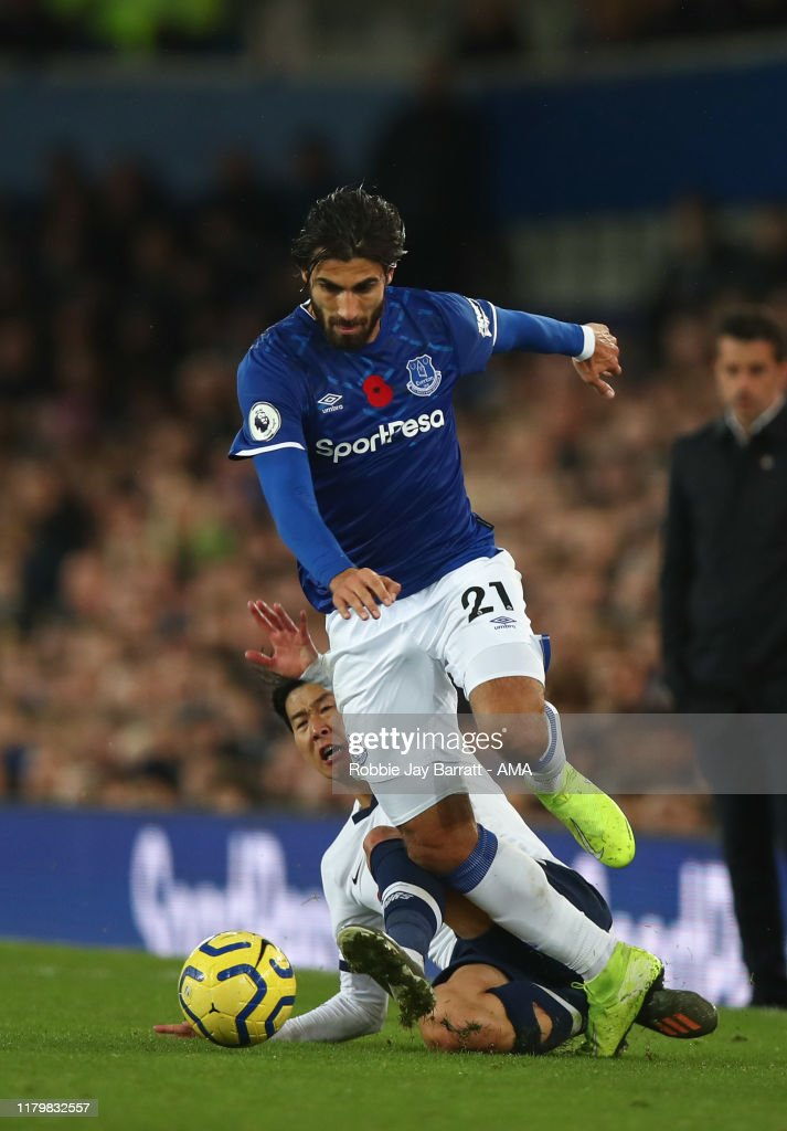 https://media.gettyimages.com/photos/son-heungmin-of-tottenham-hotspur-tackles-andre-gomes-of-everton-in-picture-id1179832557