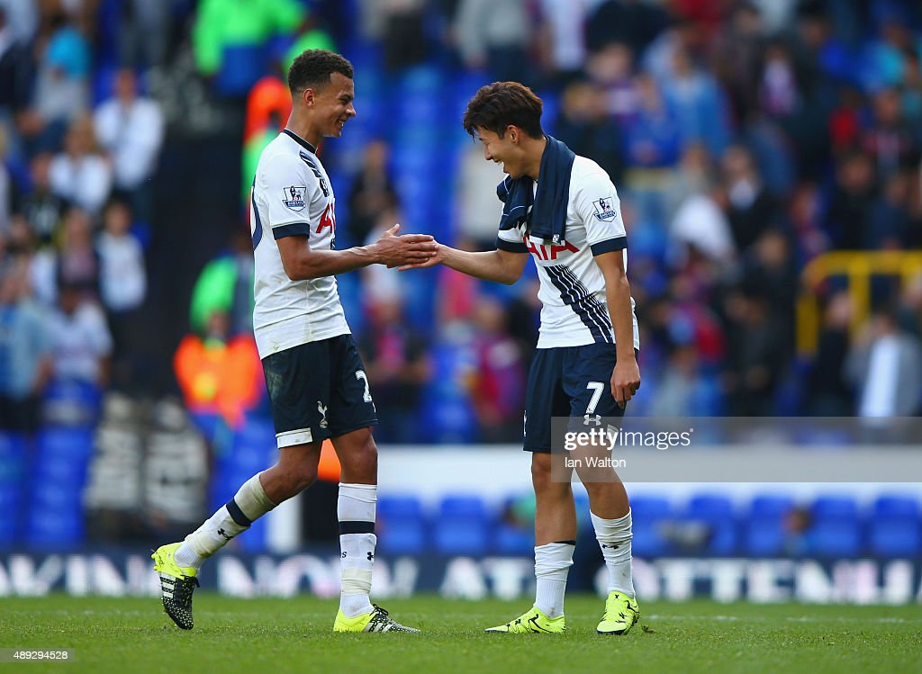 Son Heung-Min shakes hands with Dele Alli of Tottenham Hotspur after victory in the Barclays Premier League match between Tottenham Hotspur and Crystal Palace at White Hart Lane on September 20, 2015 in London, United Kingdom.