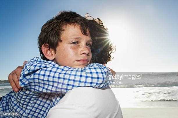 Son hugging father, portrait