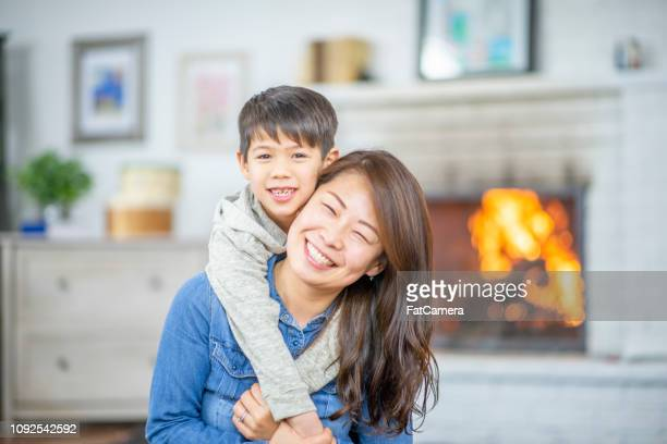 son hugging his mother - fatcamera stock pictures, royalty-free photos & images
