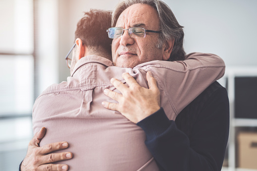 Son hugs his own father 995420532