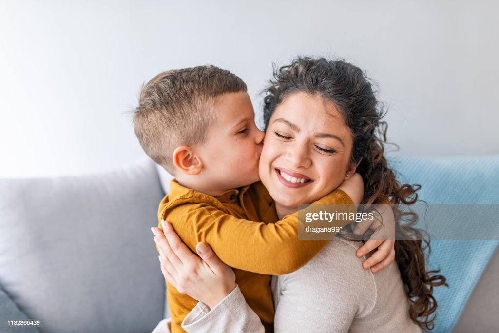 Son is kissing his mother. : Stock Photo