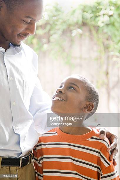 Son Looking Up at His Father Smiling
