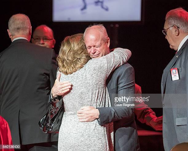 Son Mark Howe and daughter Cathy Howe of the late Gordie Howe hug during the Gordie Howe Visitation at Joe Louis Arena on June 14 2016 in Detroit...