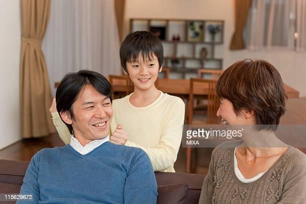 Son Massaging Father's Shoulder
