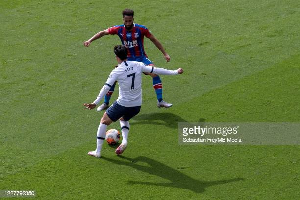 Son MinHeung of Tottenham Hotspur and Andros Townsend of Crystal Palace in action during the Premier League match between Crystal Palace and...