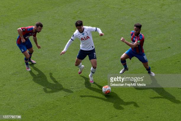 Son MinHeung of Tottenham Hotspur and James McArthur and Andros Townsend of Crystal Palace in action during the Premier League match between Crystal...