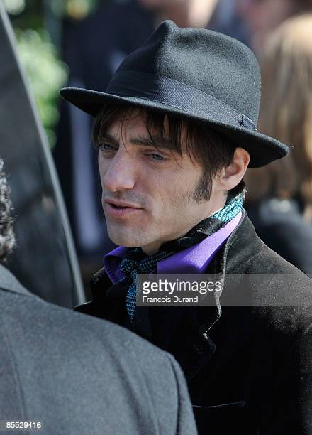 Son of Alain Bashung Arthur bashung leaves the SaintGermaindesPres church after a funeral mass for Alain Bashung on March 20 2009 in Paris France