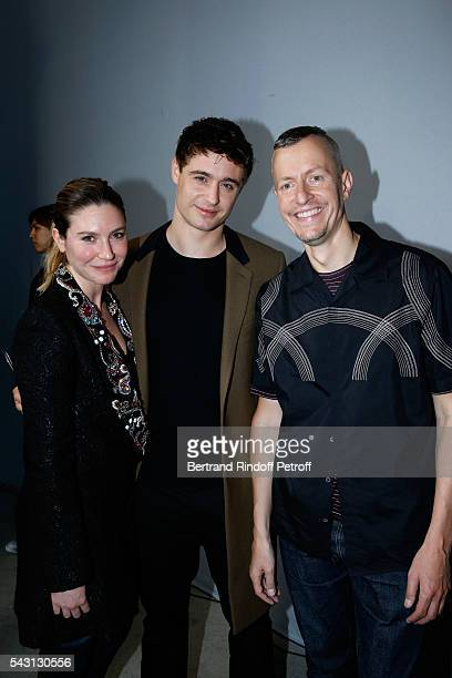 Son of Jeremy Irons, Max Irons standing between his companion Sophie Pera and Stylist Lucas Ossendrijver attend the Lanvin Menswear Spring/Summer...