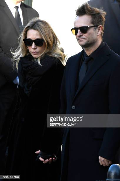 Son of late French singer Johnny Hallyday David Hallyday and daughter Laura Smet stand outside at the Eglise de la Madeleine at the start of the...