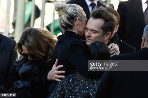Son of late French singer Johnny Hallyday David Hallyday and daughters Laura Smet Joy Hallyday Jade Hallyday and wife French singer Johnny Hallyday...