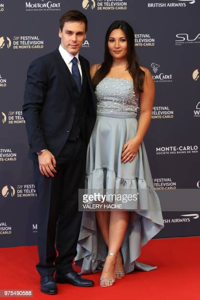 Son of Princess Stephanie of Monaco Louis Ducruet and his fiancee Marie Chevallier arrives for the screening of the film 'Jack Ryan' during the...
